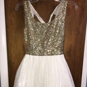 White and gold mini dress